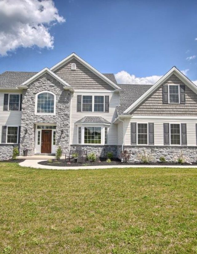 A vinyl siding and stone front custom house in lancaster county