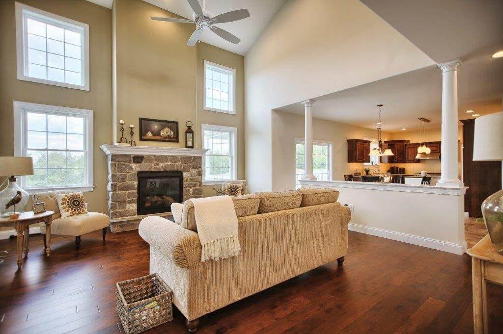 family room with stone fireplace and tan sofa