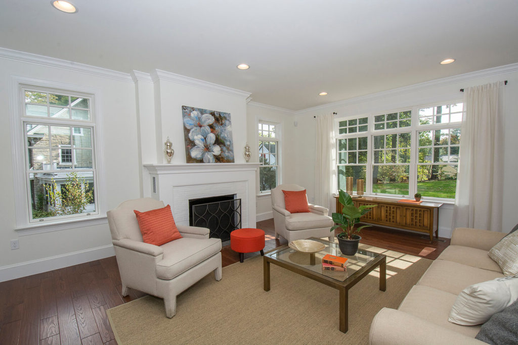 living room with renovated fireplace