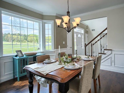 dining room table in front of bay window