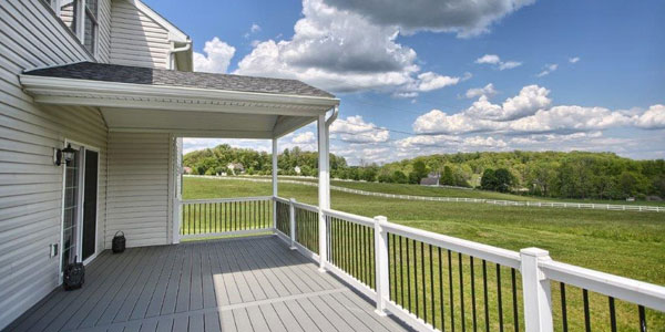 synthetic deck and vinyl handrails on new custom home in berks county